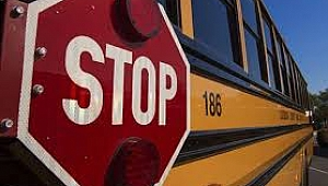 Man barges onto school bus, holds knife to driver