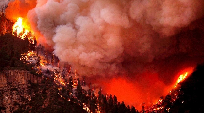 Hot, dry conditions help fuel fast-moving wildfires in the West