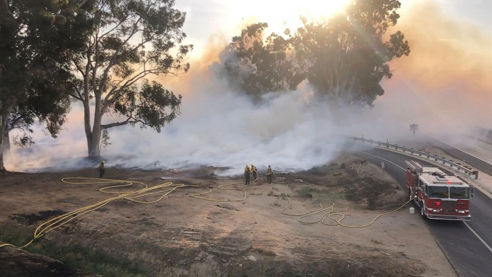 Fires in California as new storm moves across US w